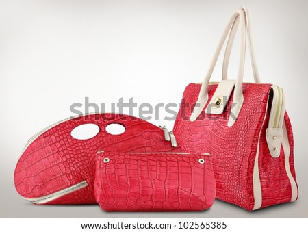 Red women bags on grey background - stock photo