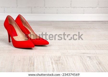 Red women shoes with  on the floor - stock photo