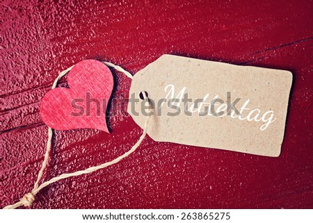red wood background with hearts - german for mothers day - stock photo