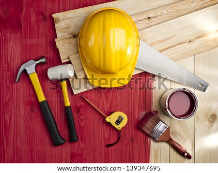 red wood floor with a brush, paint, hammer and yellow helmet - stock photo