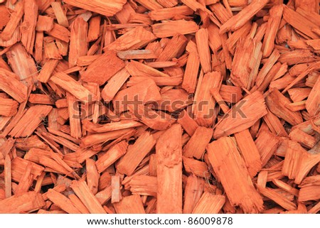 red woodchips as textured background - stock photo