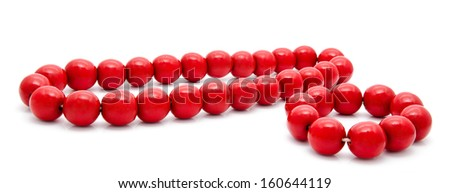 Red wooden beads and bracelet isolated on a white background