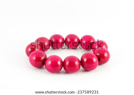 red wooden beads bracelet isolated on white - stock photo