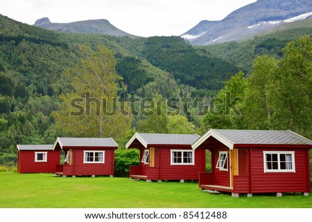Red wooden cabins at campsite in Norway - stock photo