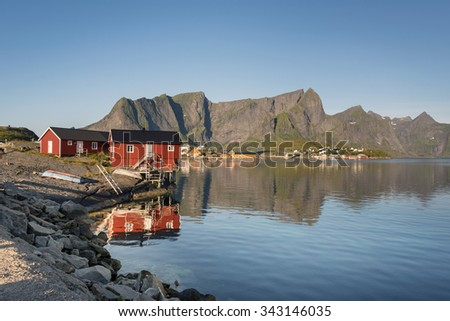 Red wooden house called rorbu at the Lofoten archipelago, North Norway - stock photo