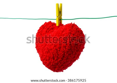 Red wool Heart on the wire,Selective Focus,white background