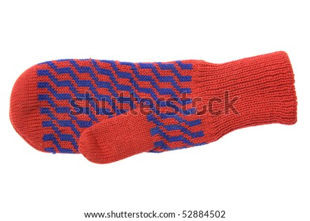 Red wool mitten with blue ornament isolated on white background - stock photo