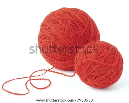 red wool yarn clews