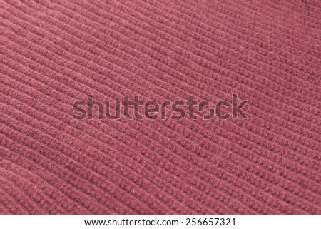 Red woolen cloth close up, background - stock photo