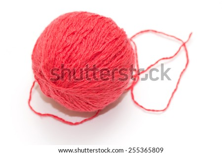 red woolen round ball of a white background - stock photo