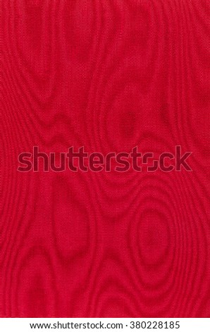 Red woven fabric with moire - stock photo
