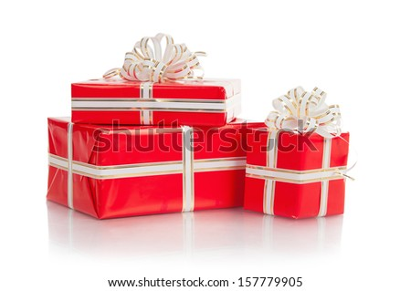 Red wrapped gift with a bow on a white background.
