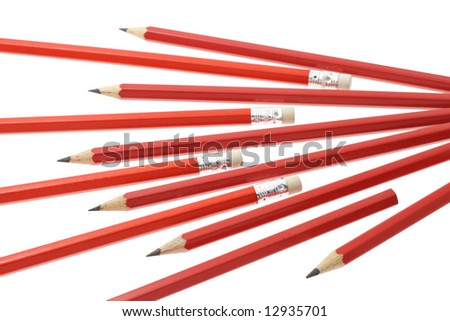 Red writing pencils arranged on white background