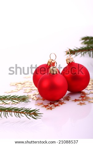 Red xmas balls and pine branch