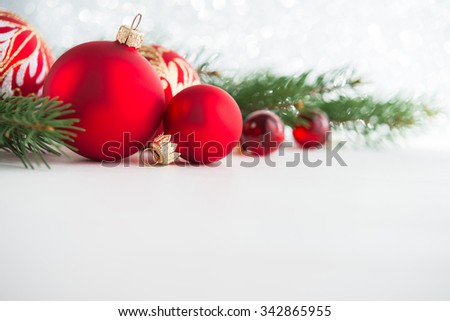 Red xmas ornaments and xmas tree on wooden background. Merry christmas card. Winter holidays. Xmas theme. Happy New Year. Space for text. - stock photo