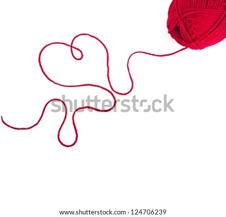 red yarn thread wit heart sign isolated on white background - stock photo