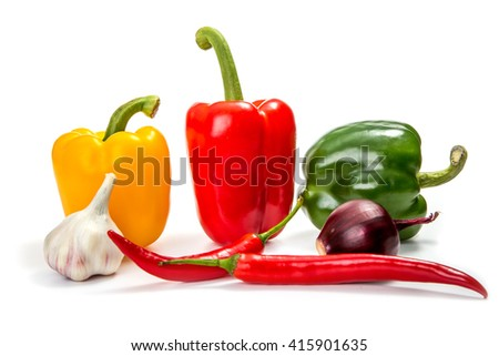 red, yellow and green bell pepper with chili pepper on a white background