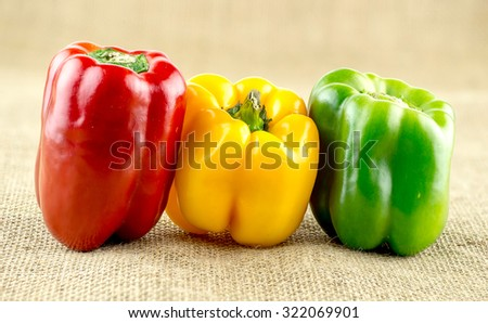 Red, yellow and green capsicum - stock photo