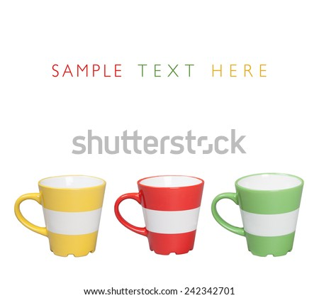 Red, Yellow and green ceramic mugs with place for your text, isolated on white background - stock photo