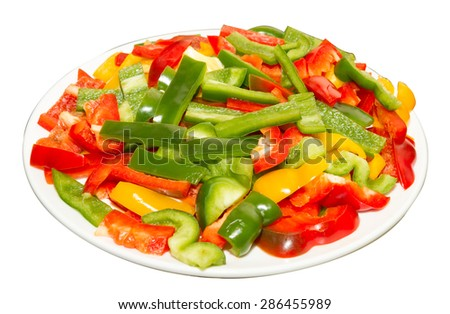 red, yellow and green paprika on white plate, on white background.