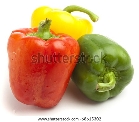 red, yellow and green pepper on white background