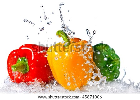 red, yellow and green pepper with water splash isolated on white - stock photo