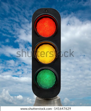 Red Yellow and Green traffic lights against blue sky backgrounds. Clipping Path included. - stock photo
