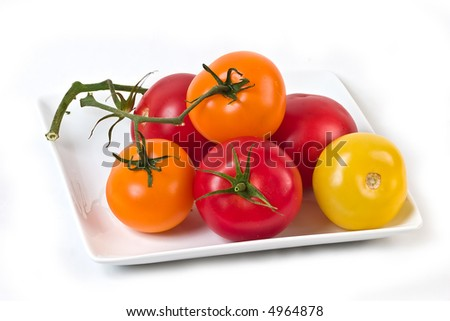 red,yellow and orange tomatoes on the vine