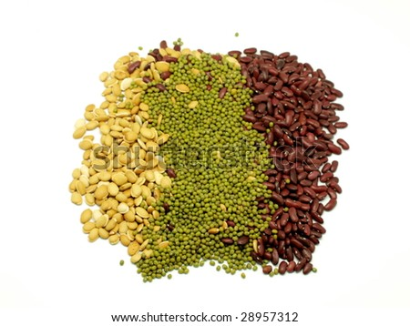 Red , yellow, green beans, peas and lentil over white background. - stock photo