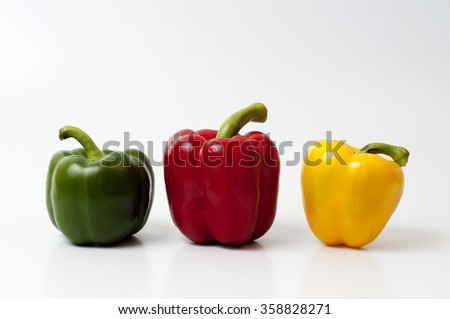 red yellow green bell peppers (capsicum) on a white isolated  background - stock photo
