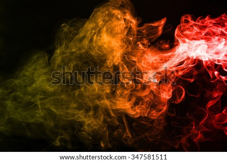 Red yellow smoke texture on dark background