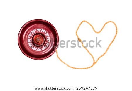 Red yoyo with heart-shaped twine on the white background. - stock photo