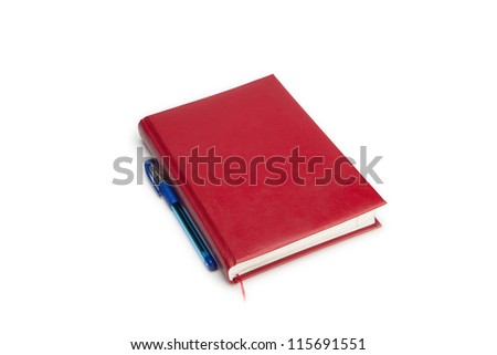 Red zapichnvya book on a white background with a ballpoint pen