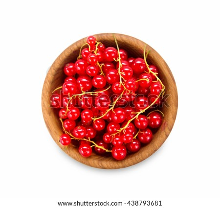 Redcurrant in a wooden bowl. Top view. Ripe and tasty currant isolated on white background. - stock photo