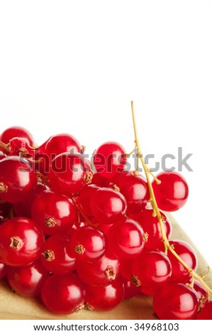 Redcurrants on green dish isolated on white background - stock photo