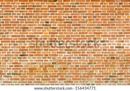 reddish brick stone wall as a texture background - stock photo