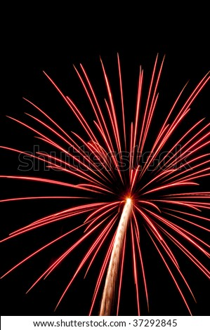 Reddish-pink burst of fireworks with white rocket trail