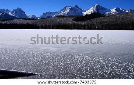 Redfish lake as it freezes over in late November, Idaho - stock photo
