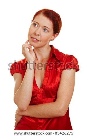 Redhaired woman thinking pensivly with hand on chin