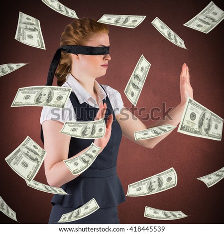 Redhead businesswoman in a blindfold against orange - stock photo