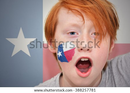 redhead fan boy with texas state flag painted on his face. on the  texas state flag background - stock photo