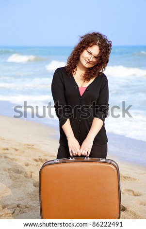 Redhead girl at outdoor with suitcase. - stock photo