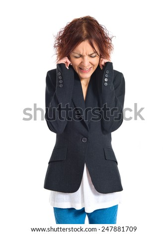 Redhead girl covering her ears  - stock photo