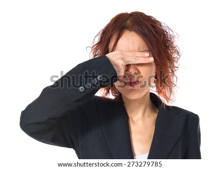 Redhead girl covering her eyes
