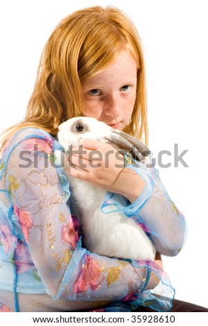 redhead girl is cuddling with a white rabbit isolated - stock photo