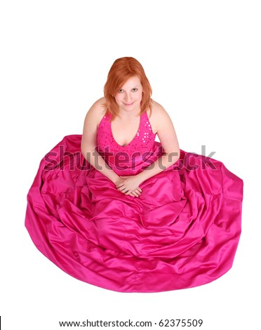 redhead girl wearing a pink prom dress isolated over white - stock photo