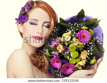 Redhead girl with flowers, isolated.