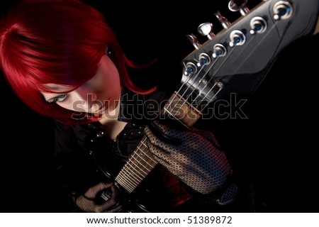 Redhead girl with guitar, selective focus on face, high angle view