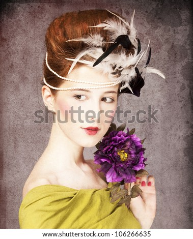 Redhead girl with Rococo hair style and flower at vintage background. Photo in old style. - stock photo