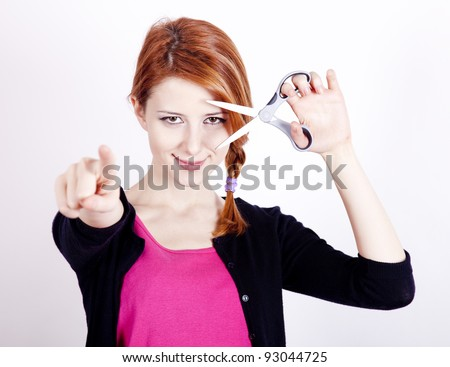 Redhead girl with scissors. - stock photo